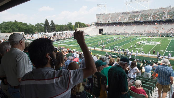 Fans attend an open house for CSU's new on-campus football stadium on Saturday, August 5, 2017. More than 10,000 Rams fans got their first look at the facility with a concessions and amenities in operation.