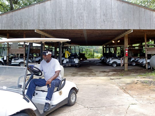 A Grove Park Golf Course employee retrieves a golf cart from the equipment barn at Grove Park Golf Course Thursday. The Jackson City Council is considering a public-private partnership to manage Grove Park Golf Course.