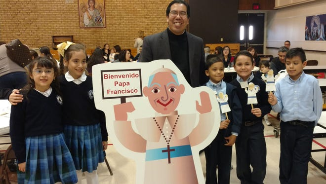 Emilia Torrion, left to right, Paulina Gama, the Rev. Tony Celino, Nicolas Gomez, Raul Solis and Javier Martinez.