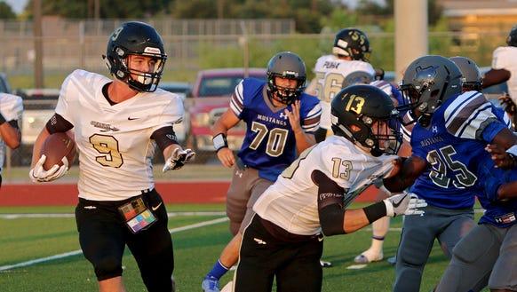 Quanah's Matthew Day (9) takes over as quarterback