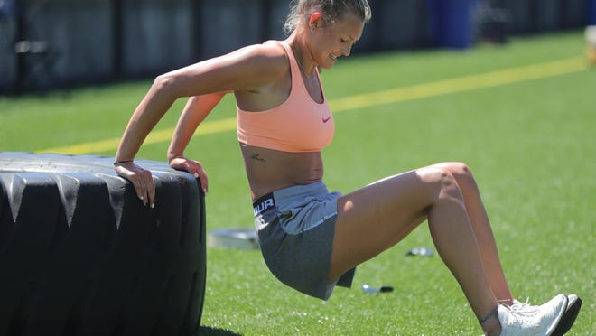 Former University of Akron women's basketball player Haliegh Reinoehl works out at the Lee Jackson Practice Field on Monday, June 8, 2020, Akron, Ohio, at the University of Akron. Reinoehl just graduated and will be playing basketball in Switzerland this fall.