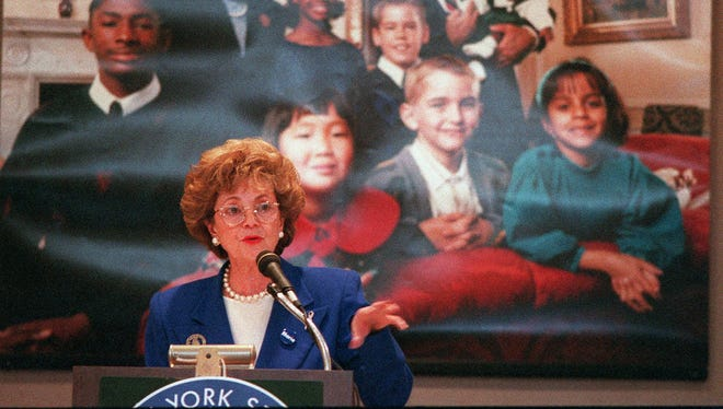 Matilda Cuomo hosts a town meeting on children's issues as part of the state's Decade of the Child program back in 1994. In the promotional poster in the background is Gov. Mario Cuomo.