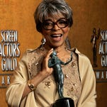 "In this Jan. 27, 2008 file photo, Ruby Dee poses with the award for outstanding performance by a female actor in a supporting role for her work in ""American Gangster"" at the 14th Annual Screen Actors Guild Awards, in Los Angeles. Dee, an acclaimed actor and civil rights activist whose versatile career spanned stage, radio television and film, has died at age 91, according to her daughter. Nora Davis Day told The Associated Press on Thursday, June 12, 2014, that her mother died at home at New Rochelle, New York, on Wednesday night."