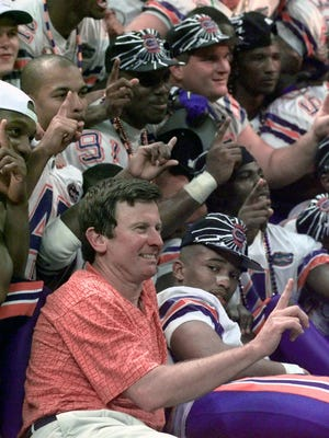 Florida coach Steve Spurrier poses with his team after they defeated Florida State 52-20 in the Jan. 2, 1997 Sugar Bowl at the Superdome in New Orleans.
