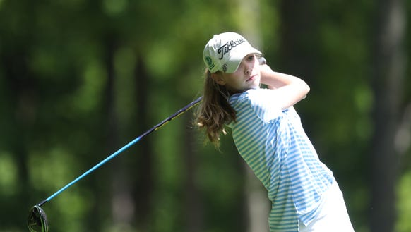 Ursuline's Alice Hodge hits a tee shot during the girls