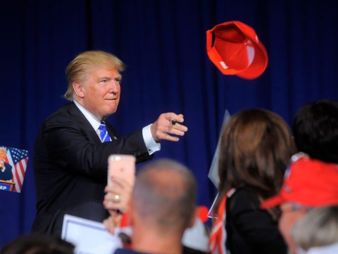Republican  presidential nominee Donald Trump tosses