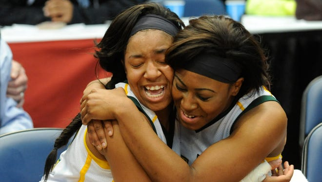 Jeff Davis' Sydney Horne and Lavarsha Thigpen hug after winning the 7A state championship game at the AHSAA state finals in Legacy Arena at the BJCC in Birmingham on Saturday