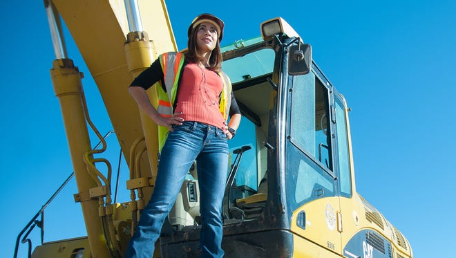 Rachel Bustos, president of Burn Construction Co., poses for a photograph at a jobsite on Tuesday in Picacho Hills.