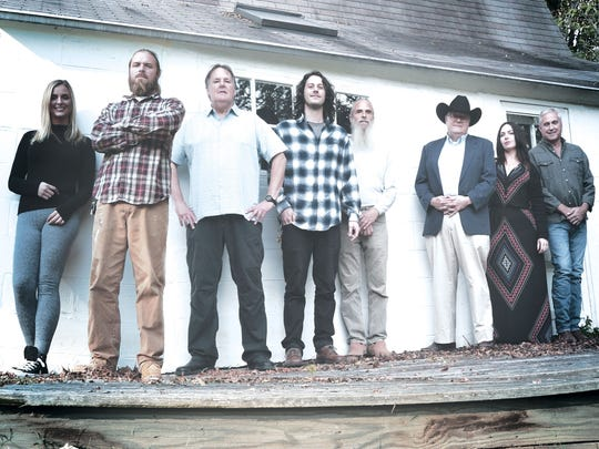 Jeff Bove wears a cowboy hat while surrounded by his band. From left to right: Kat Lee, Dave Lee, David Poland, Dan White, Lindsay Lee, Bove, Alicia Maxwell and Tommy Alderson.