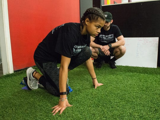 Brianna Stevenson works with trainer Cody Revel at