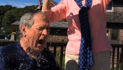 Former President George W. Bush accepts the challenge, with a little assist from the former First Lady.