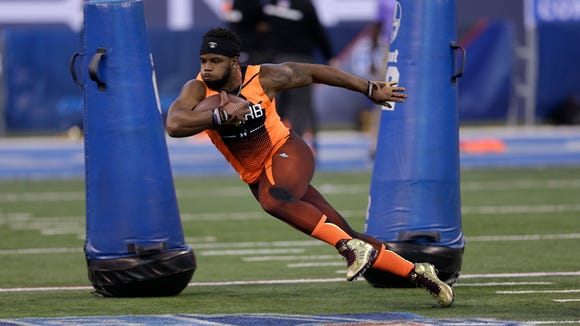 Mississippi State running back Josh Robinson runs a drill at the NFL football scouting combine in Indianapolis, Saturday, Feb. 21, 2015. (AP Photo/David J. Phillip)