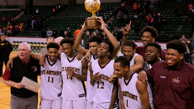 St. Anthony raising the 2016 state boys basketball Tournament of Champions trophy.