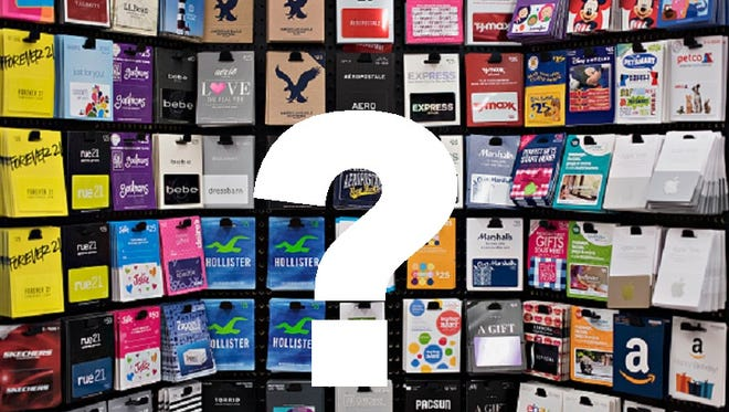 Gift cards hang at a Kroger store in Peoria, Illinois, U.S., on Tuesday, June 16, 2015. The Kroger Co. is expected to report quarterly earnings on Thursday, June 18, 2015. Photographer:  Daniel Acker/Bloomberg