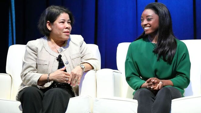 Mrs Biles and Simone Caption: Mrs. Nellie Biles and Simone Biles share their thoughts onthe making of the most decorated American gymnast.