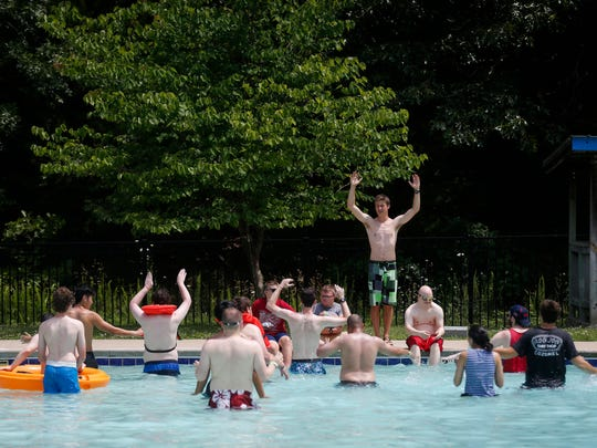 Campers and staff cool off in the pool at Camp Barnabas on Wednesday, June13, 2018.