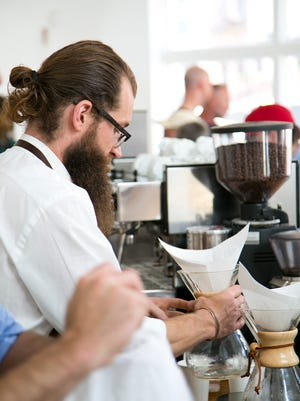 Rom Wells, of Cheapside Cafe, makes a Chemex coffee.