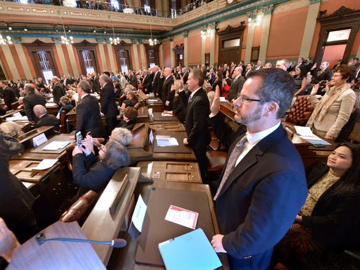 Rep. Todd Courser, R-Lapeer, takes his oath of office