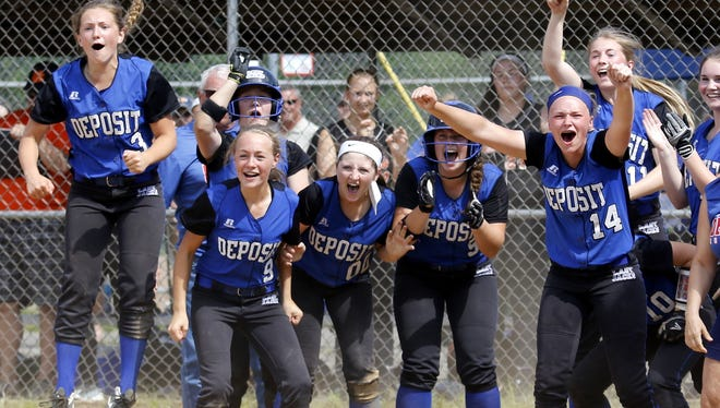 Deposit players celebrate at home plate after Kyra Martin hit a walk-off two-run home run in the eight inning to capture the Section 4 Class D title Saturday at BAGSAI Complex.