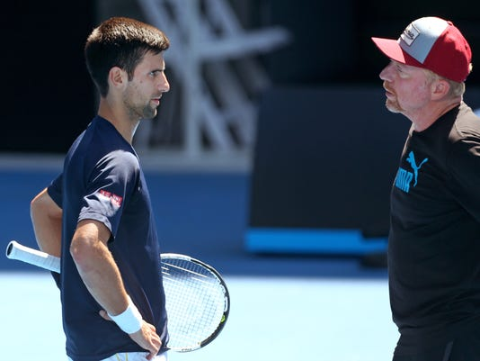 Novak Djokovic of Serbia, left, talks with his coach Boris Becker, during a practice session, ahead of the Australian Open tennis championships in Melbourne, Australia, Saturday, Jan. 16, 2016.(AP Photo/Rafiq Maqbool)