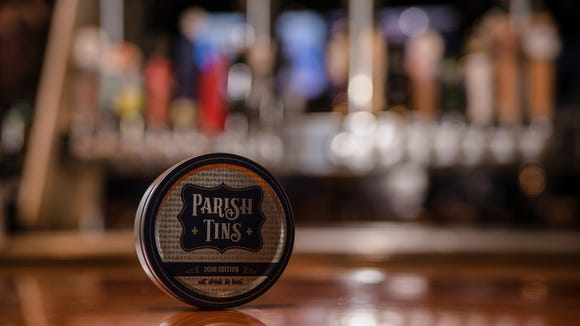Parish Tins feature 20 coasters with $10 discounts to local restaurants.