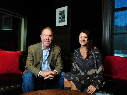 Mark Brown, vice president-general manager of Round Hill Music, and Kari Smith, studio manager, sit in a writing room at Quad Studios.