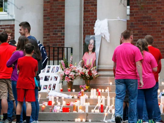 A photo of Jacelyn D. O'Connor is surrounded by flowers and candles at Morris Central School in the Village of Morris on Monday August 7, 2017.
