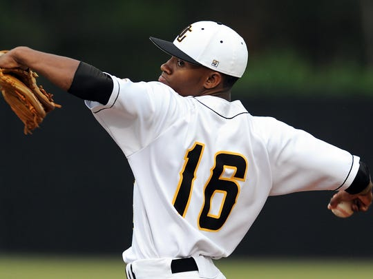 Oak Grove pitcher J. C. Keys delivers a pitch Tuesday during Class 6A South State Finals game against Biloxi at Oak Grove High School.
