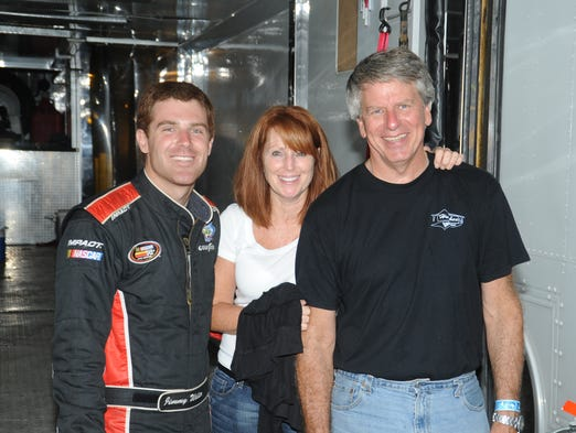 Jimmy Weller, left, shown here with mother Ronnie Weller and father Jim Weller, nearly died in a sprint car accident while racing on the Dirt Track at Charlotte Motor Speedway in October 2004.