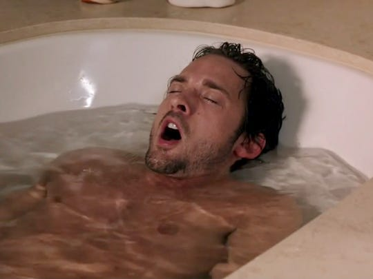 "After losing his inability to feel physical sensations ""The Midnight Man"" Grady (Will Kemp) experiences the joys of a warm soak in the tub."