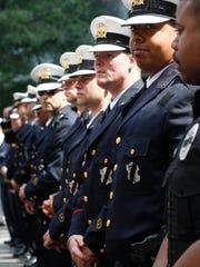 Policemen and women gather from across Cincinnati for
