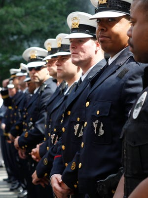 Policemen and women gather from across Cincinnati for an annual memorial to honor fallen comrades Friday, May 19, 2017 at Fountain Square.