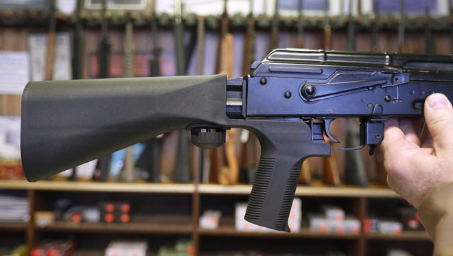 A bump stock device is installed on a AK-47 semi-automatic rifle at a gun store on October 5, 2017 in Salt Lake City, Utah.