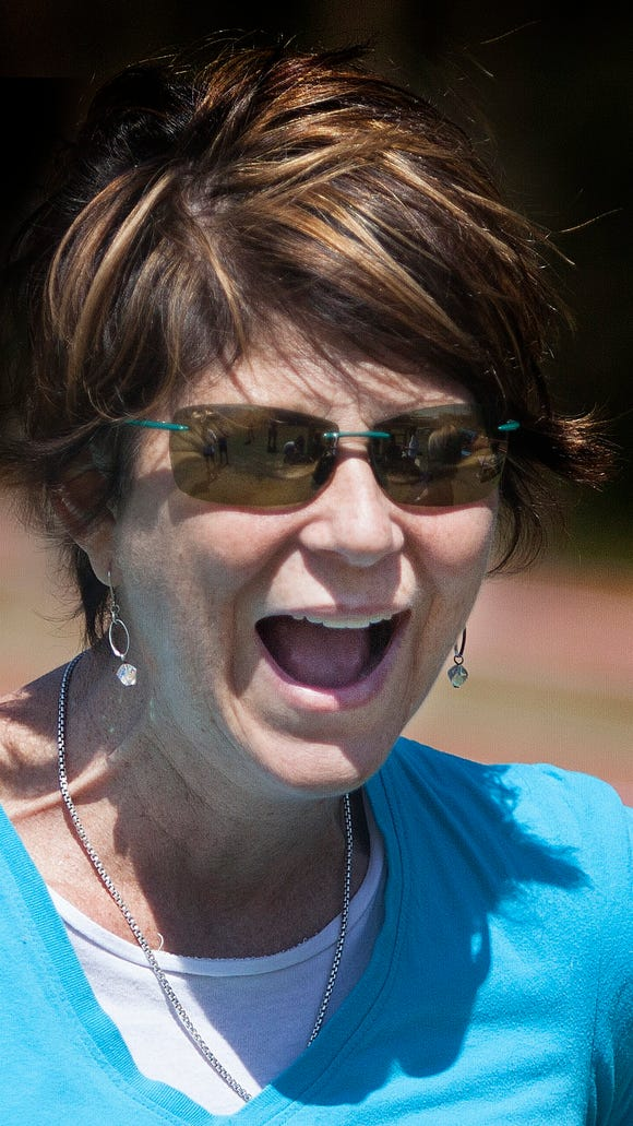 Joanna Francis, who helped create the Joanna Francis Living Well Foundation, loved to walk and run. She is seen her during a walk with 70 students during a fund raiser at the Maclay High School.