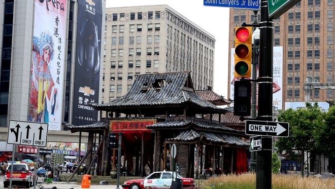 """Part of downtown Detroit is transformed into Hong Kong for the movie """"Transformers 4."""""""