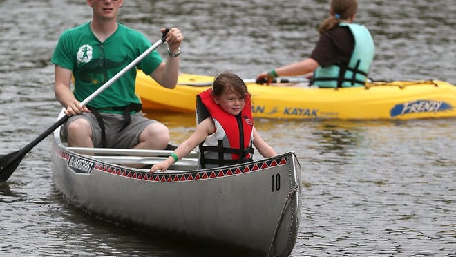 Adam Sauceda/Photographer Andrew and Evie Britt, 3, take a canoe ride down the Concho River during Goodfellow Appreciation Day on Saturday at the Bill Aylor Memorial RiverStage.