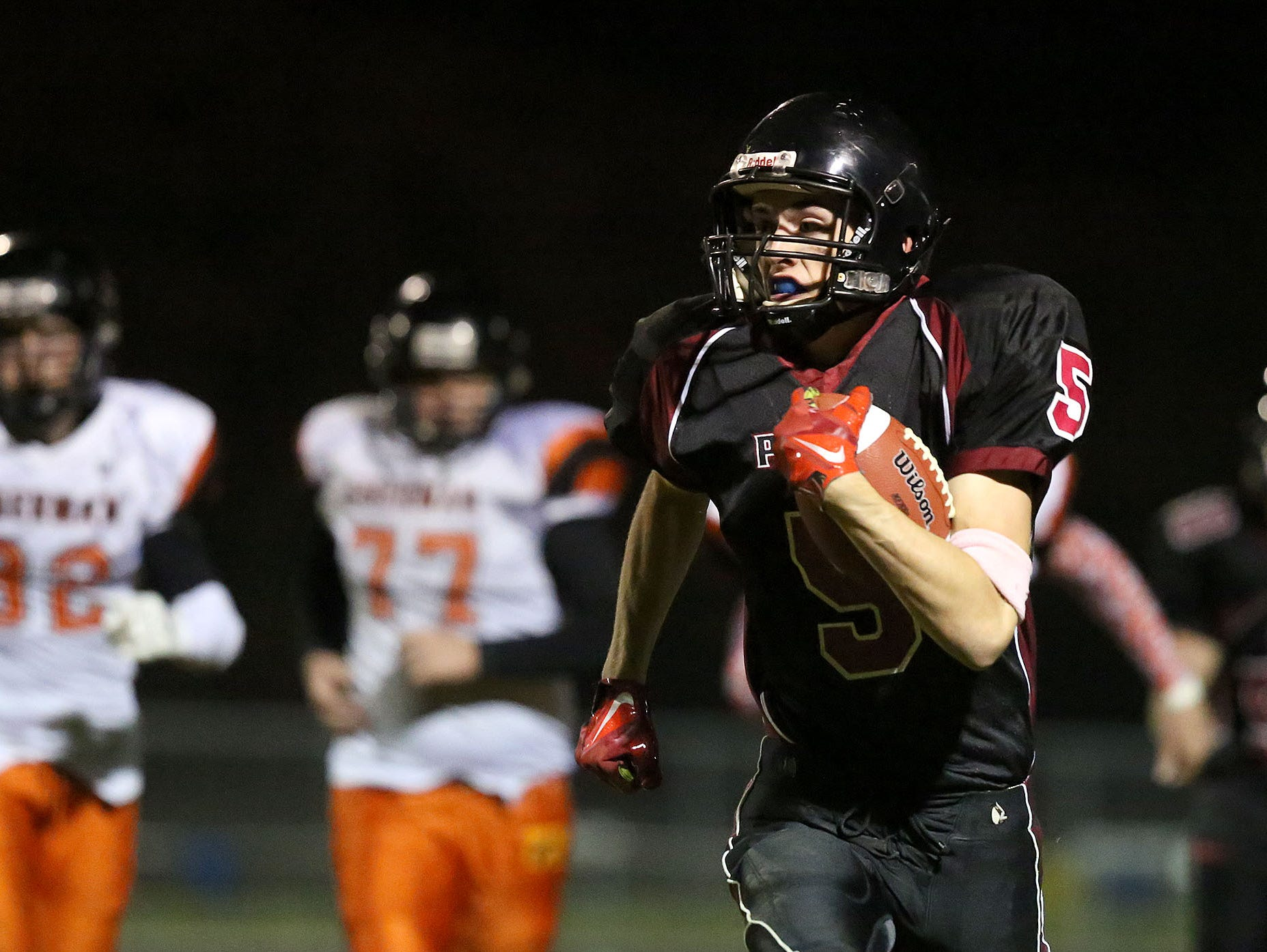 Perrydale running back Haylen Janesofsky (5) runs for a touchdown during their game on Friday, Oct. 23, 2015, in Perrydale, Ore.
