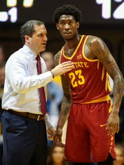 Iowa State Cyclones head coach Steve Prohm talks with Iowa State Cyclones forward Zoran Talley Jr. (23) during the first half against the West Virginia Mountaineers on Feb. 24, 2018, at WVU Coliseum.