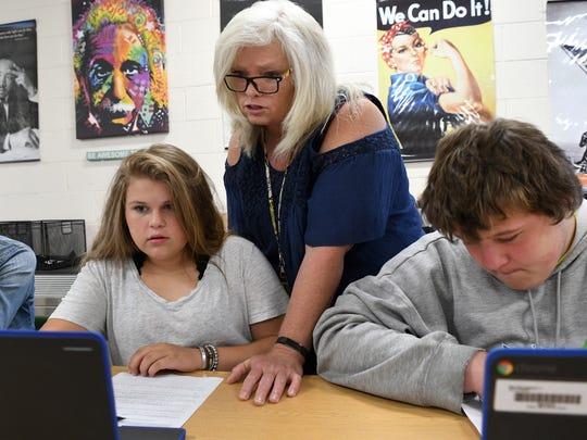 Cynthia Cupp works with Destiney Bryant on a assignment in her AP Human Geography class Carter High School  Wednesday, Aug. 23, 2017. At right is Clarence Weaver. More students took and passed AP tests in Tennessee than ever before last school year.