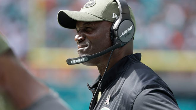 New York Jets head coach Todd Bowles watched the game, during the first half of an NFL football game against the Miami Dolphins, Sunday, Nov. 4, 2018, in Miami Gardens, Fla. The Dolphins defeated the Jets13-6. (AP Photo/Lynne Sladky)