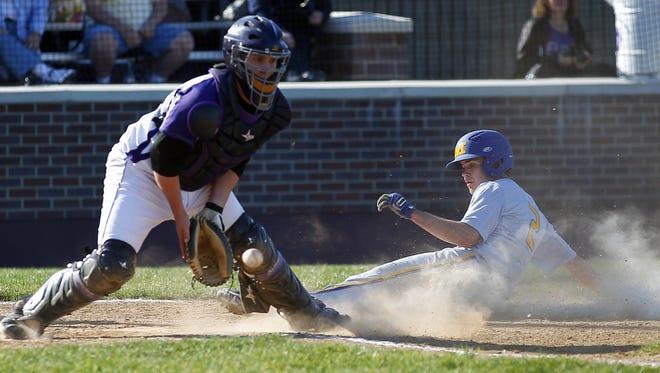 Elder catcher Sam Hauer, left, drove in the winning run with a double to right-center field in the bottom of the fourth inning.
