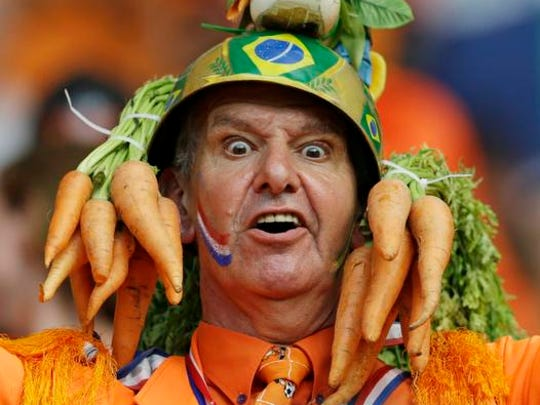A Dutch fan wears homemade hat during the group B World Cup soccer match between Spain and the Netherlands at the Arena Ponte Nova in Salvador, Brazil, Friday, June 13, 2014. (AP Photo/Natacha Pisarenko)