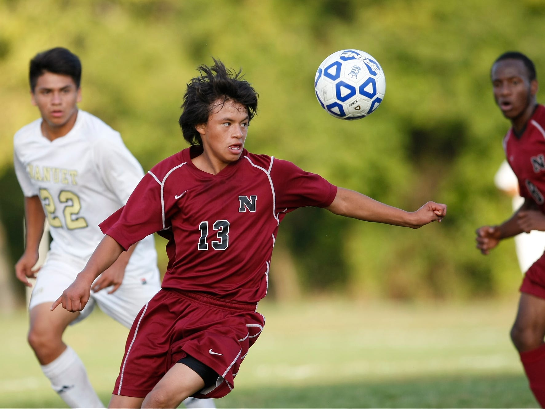 Nyack's Jose Gagliardi (13) controls the ball during a boys soccer game against Nanuet at Nanuet High School on Wednesday, Oct. 21, 2015.