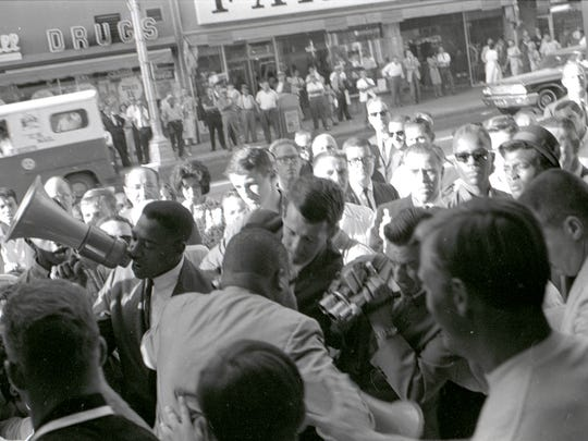 Hal Brown, a York native who graduated from William Penn High School in 1952, leads a demonstration by the San Diego chapter of the Congress of Racial Equality (CORE) at Bank of America in August 1964. CORE led sit-in demonstrations at businesses in San Diego to protest discriminatory employment practices.
