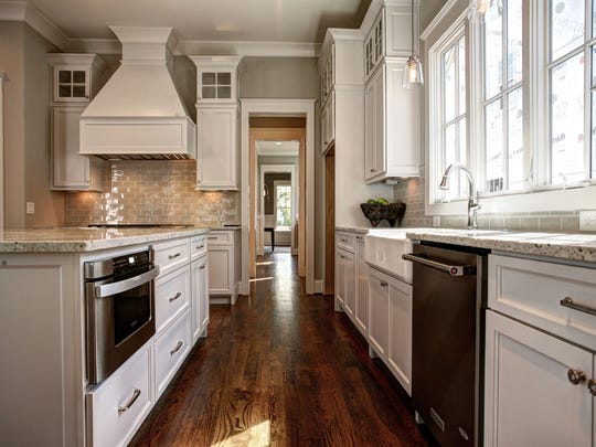 Fashion meets function in this gourmet kitchen that features granite countertops, a stylish backsplash and stainless-steel appliances.