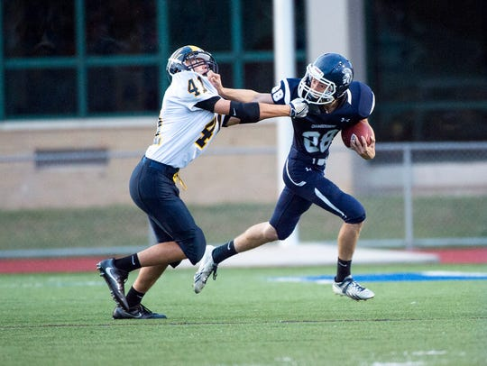 Greencastle's Mike Bunder tries to tackle Trojan's