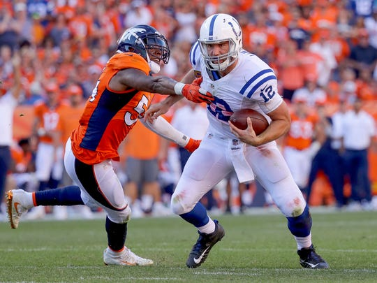 Indianapolis Colts quarterback Andrew Luck (12) is pressured from the pocket by Denver Broncos inside linebacker Brandon Marshall (54) during the fourth quarter at Sports Authority Field at Mile High in Denver on Sunday, September 18, 2016.