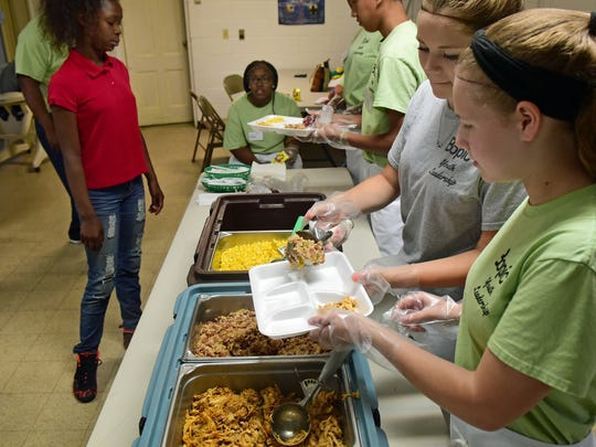 The BOPIC Youth Leadership program serves lunch Tuesday, June 27, 2017 at John Wesley AME Church, Chambersburg.