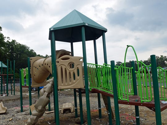Playground equipment is being assembled on Wednesday, July 5, 2017 at  Greene Township Park, Scotland.