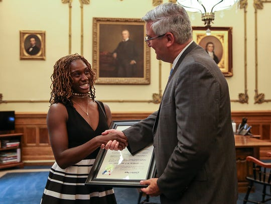 Pike High School track star Lynna Irby is awarded a